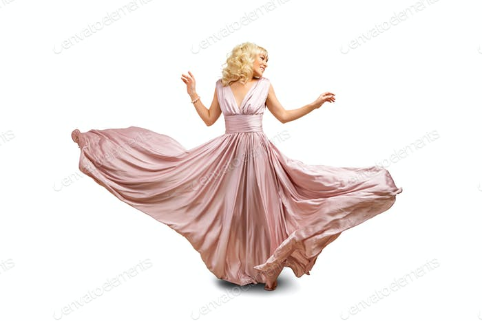 girl in flying dress isolated on white background