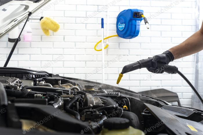 Car detailing  maintenance cleaning engine with hot steam high pressure washing
