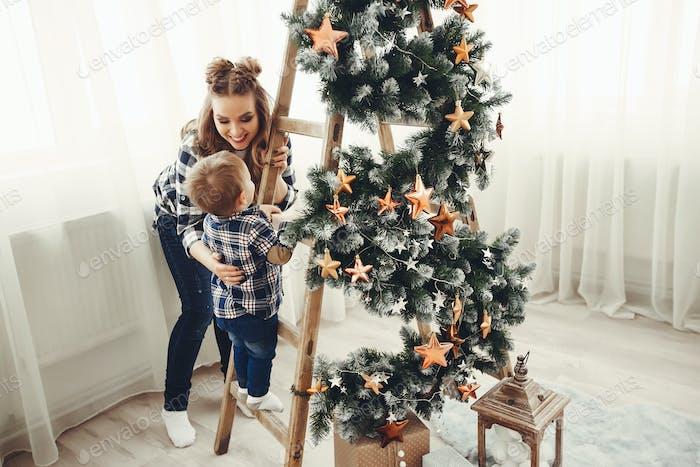 Cute family sitting near Christmas tree