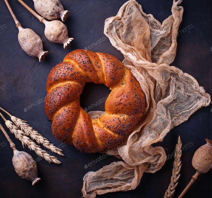 Sweet bun with poppy seeds.