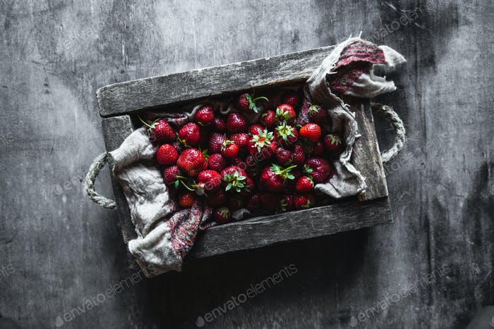 Fresh strawberries in the box on wooden vintage table, Healthy food, fruit