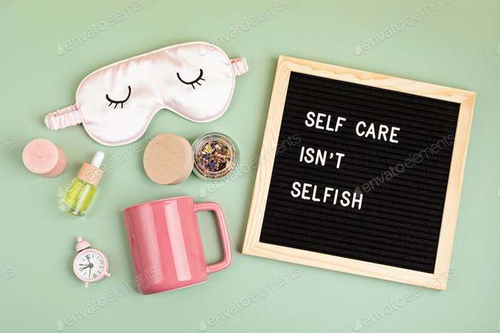 Self care is not selfish. Felt letter board with sleep optimization products, concept of rest