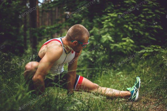Male in sportswear doing body extension
