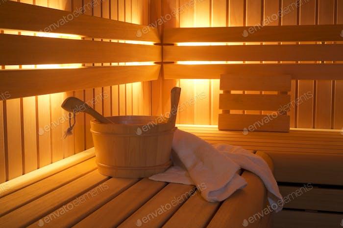 55303,Bucket and towels in sauna