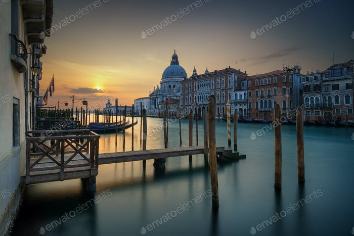 View of the Grand Canal and Basilica Santa Maria della Salute during sunrise, Venice, Italy