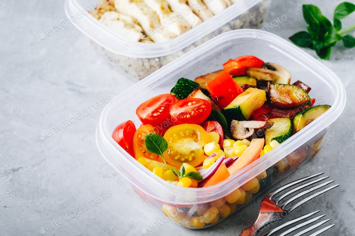 Vegan meal prep lunch box container with grilled and fresh vegetables