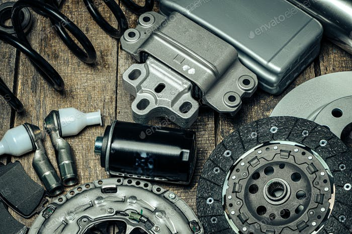 Car parts set on wooden background close up