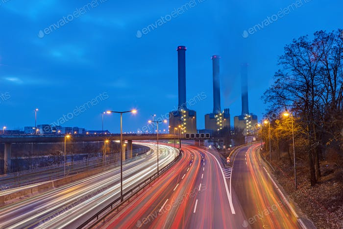 Power station and highway at dawn