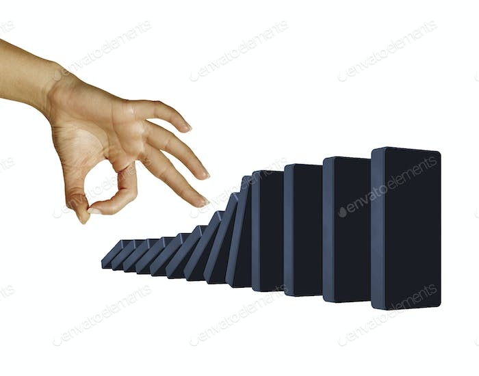 Hand toppling dominoes isolated