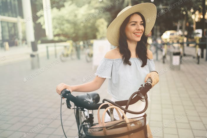 Beautiful woman using bike