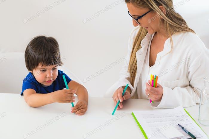 Child psychology, preschooler doing logic tests