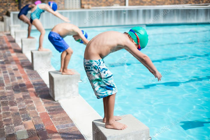 Little swimmers ready to jump in pool