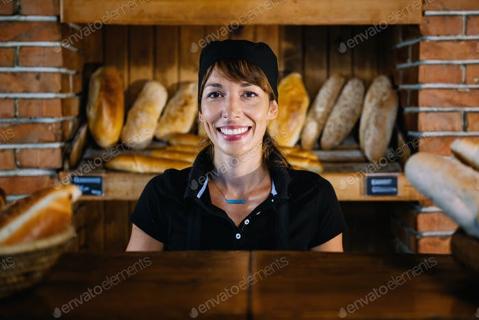 Bakery Assistant Posing At Bakery Shop