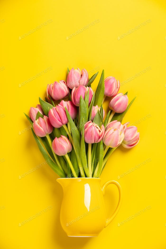 Fresh pink tulips in a jug, close up