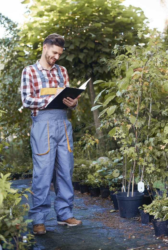 Man controlling growth of seedling