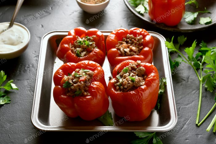 Stuffed red peppers with minced meat, rice, onion