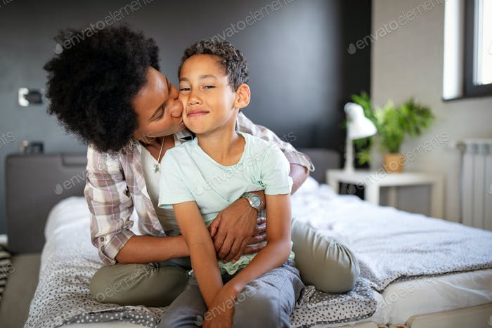 Mother playing bonding hugging with her son. Happy family time