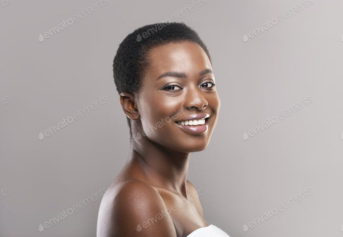 Portrait of attractive black woman with short hair