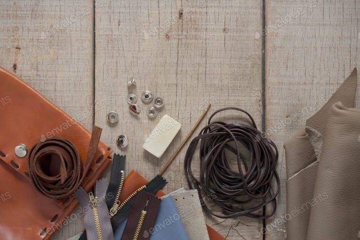 Leather and accessories on wooden