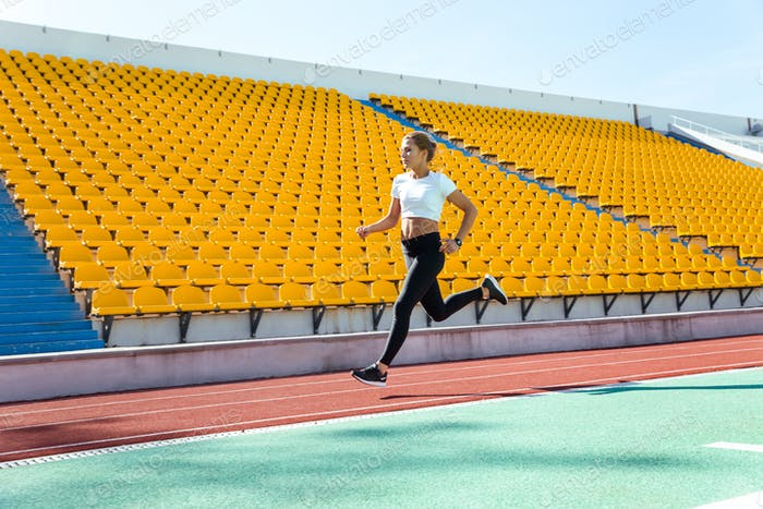 Woman running on stadium