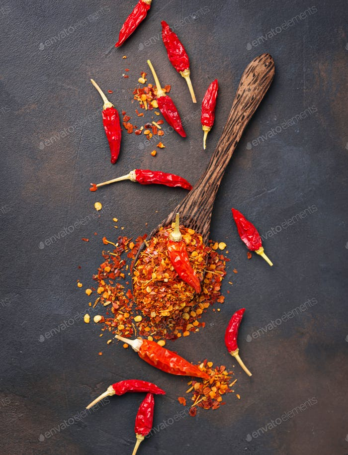 Red hot chili peppers on rusty background