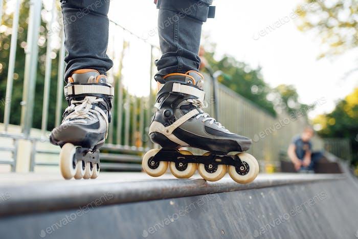 Roller skating, male skater standing on ramp