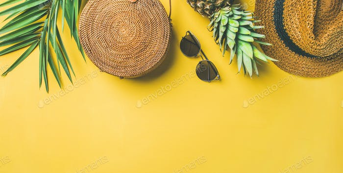 Colorful summer female fashion outfit over yellow background, wide composition