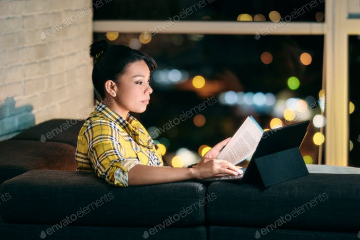 Woman working from home at night