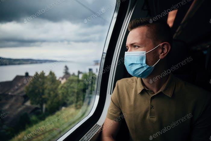 Man wearing face mask inside train