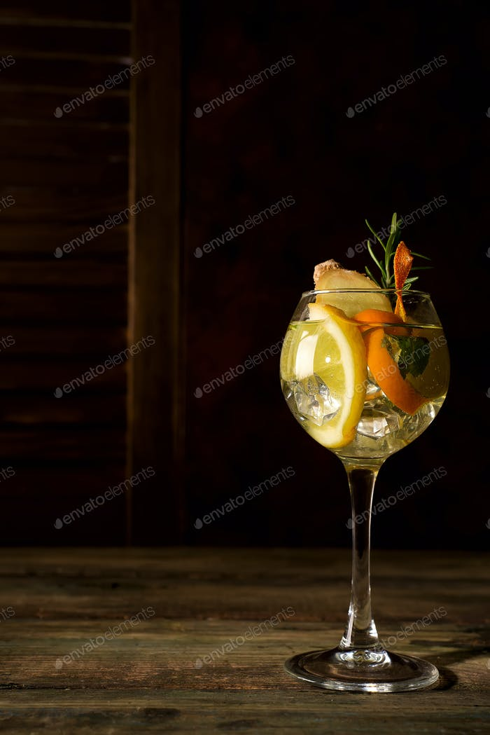 Fresh mojito drink placed on dark wooden backgorund, copy space