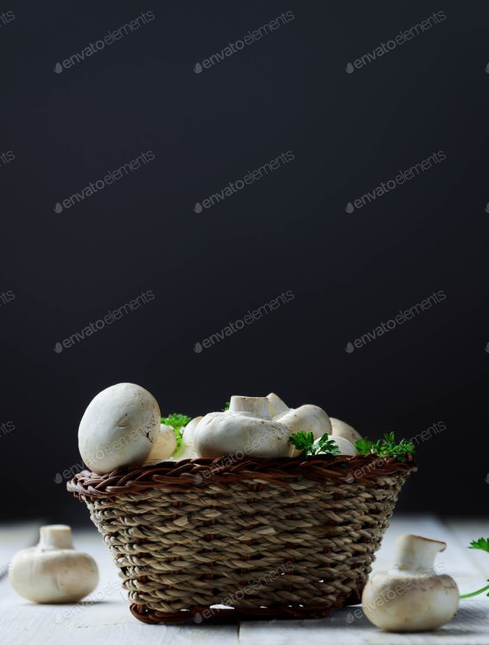 Champignon mushrooms in basket