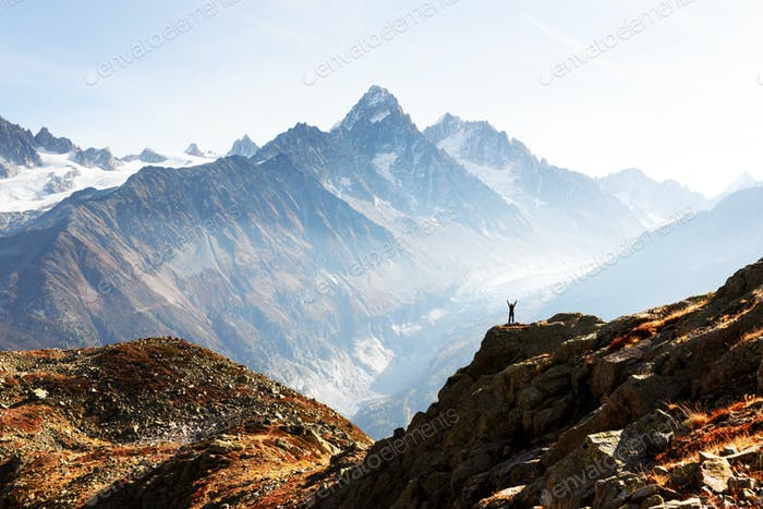 Amazing view on Monte Bianco mountains range with tourist on a foreground