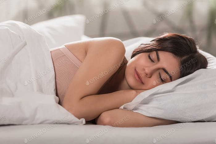 attractive girl sleeping in bed at home