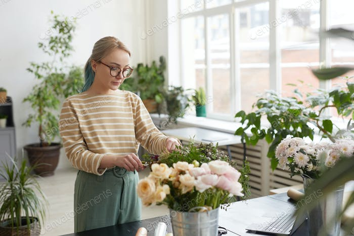 Female Florist Creating Bouquet in Workshop