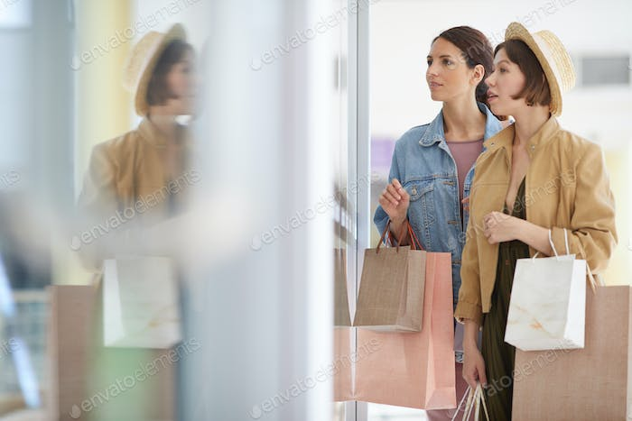 Young women choosing clothing
