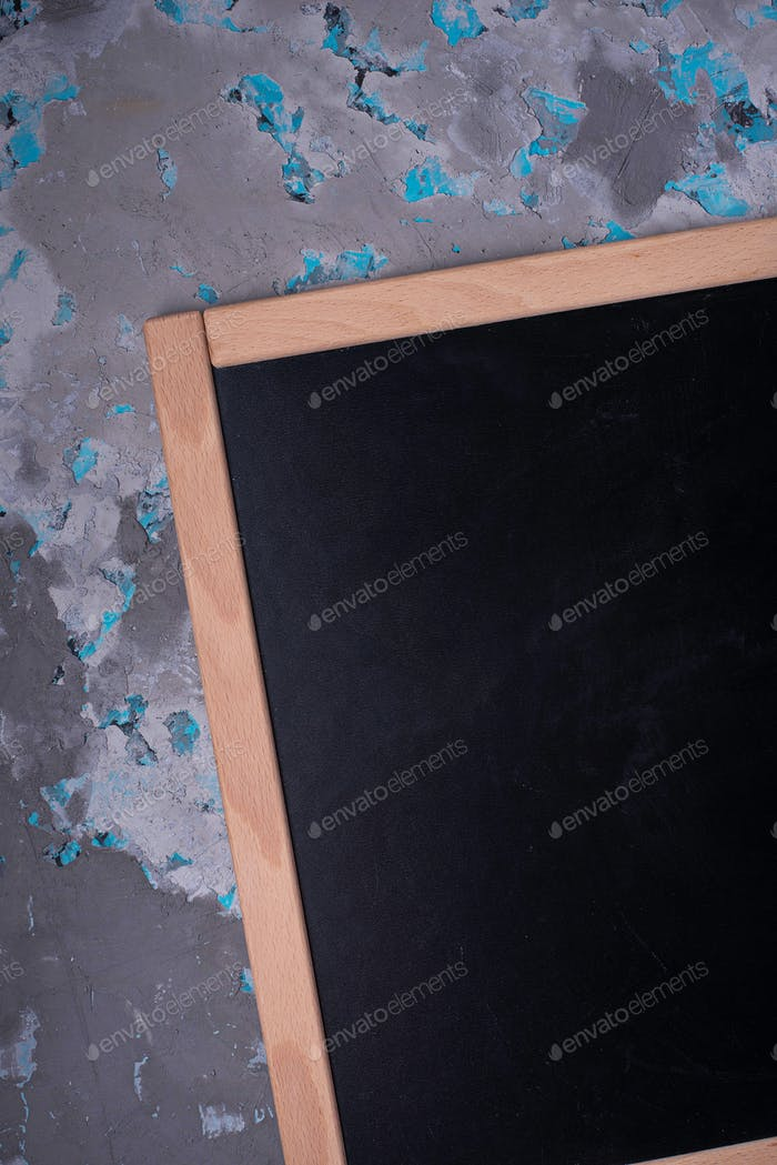Empty chalkboard in wooden frame