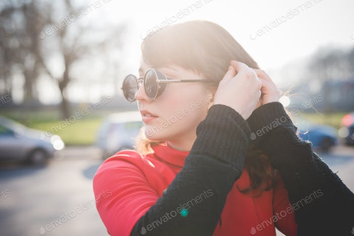young beautiful red dressed vintage hipster woman
