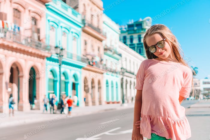 Tourist girl in popular area in Havana, Cuba. Young kid traveler smiling