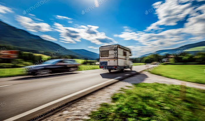 Family vacation travel, holiday trip in motorhome, caravan car motion blur