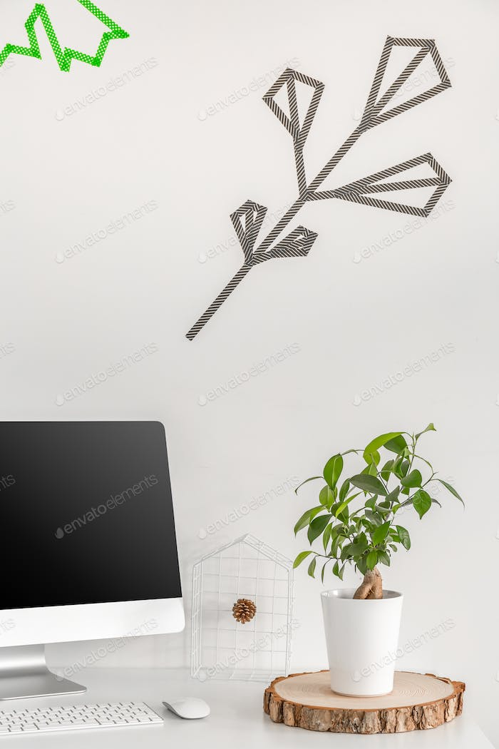 Minimalist workstation with a potted plant