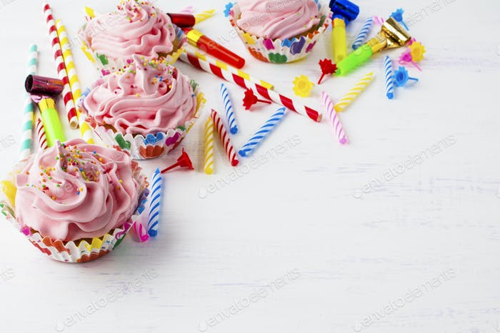 Birthday background with cupcakes