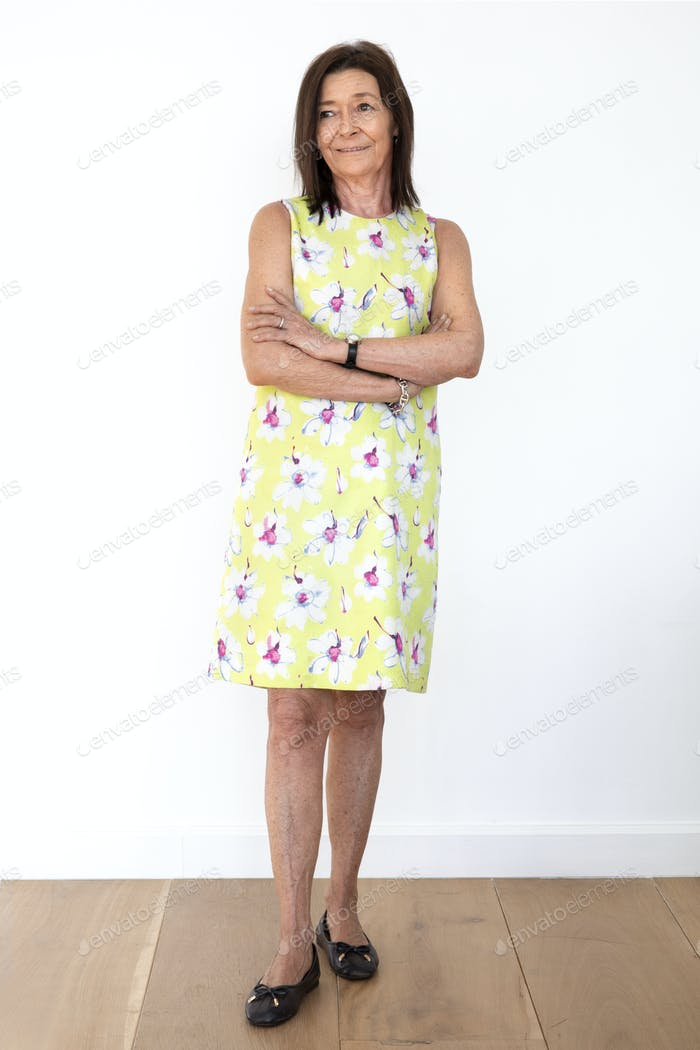 Happy senior woman in a floral dress