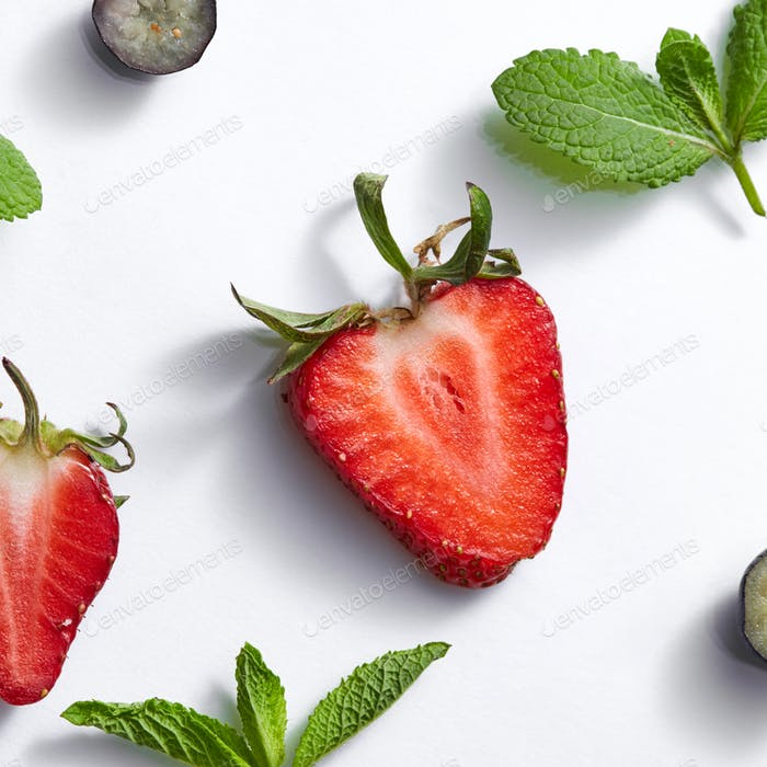 Fruits summer pattern with ripe strawberry, blueberry, leaf of mint on a white background