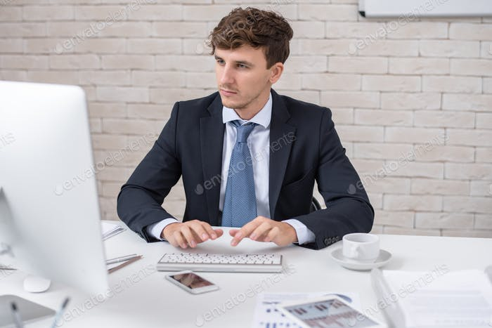 Handsome Businessman Using PC in Office