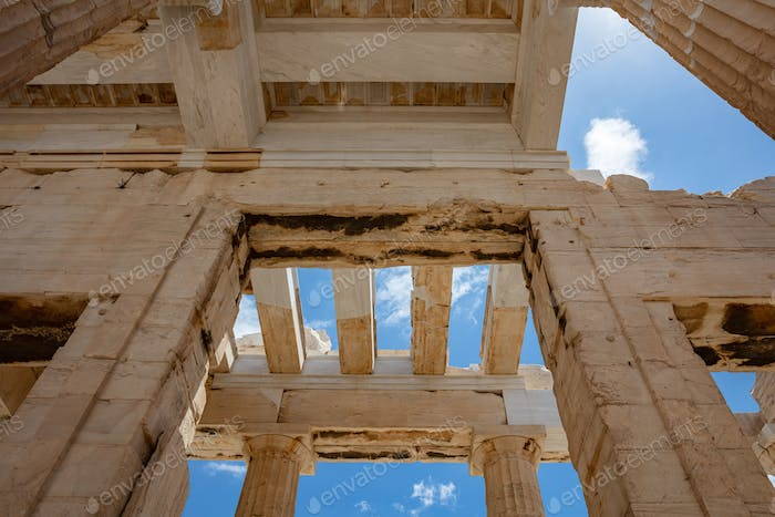 Athens, Greece. Propylaea in the Acropolis, monumental gate roof, blue cloudy sky