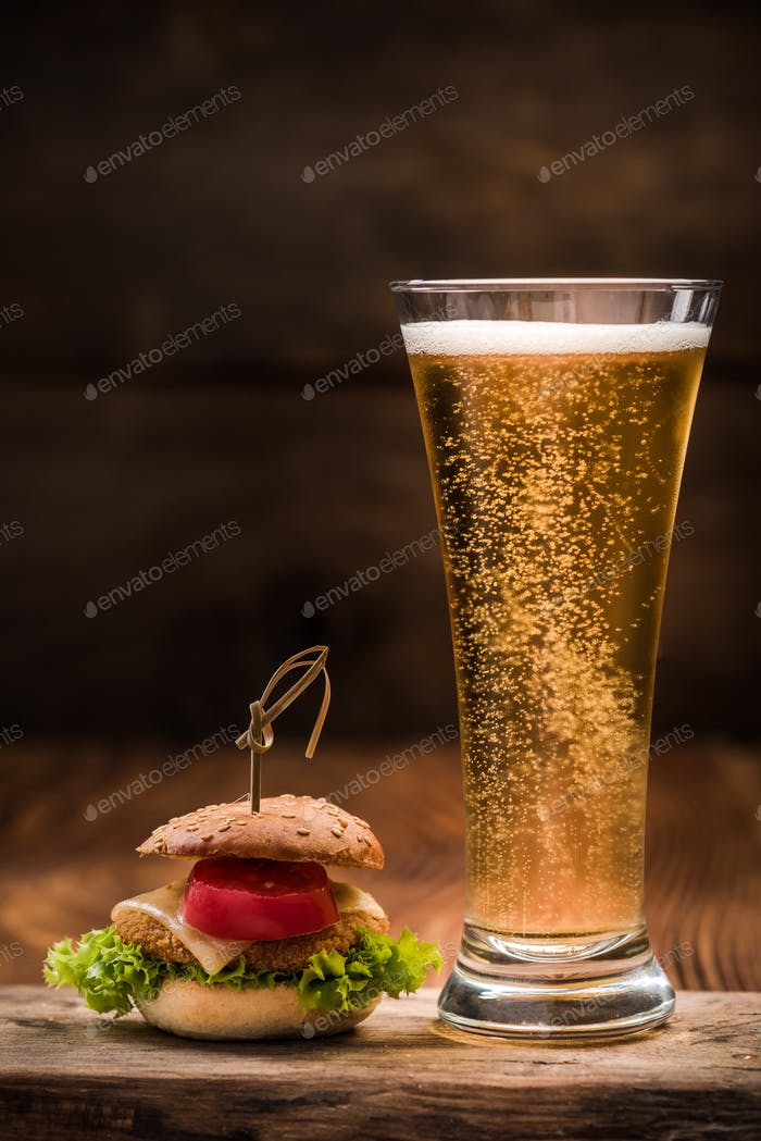 Chicken burger with glass of beer