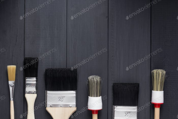 paint brush on plank wooden board