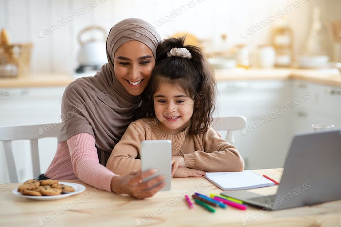 Selfie Fun. Happy Muslim Woman Taking Photo With Little Daughter On Smartphone
