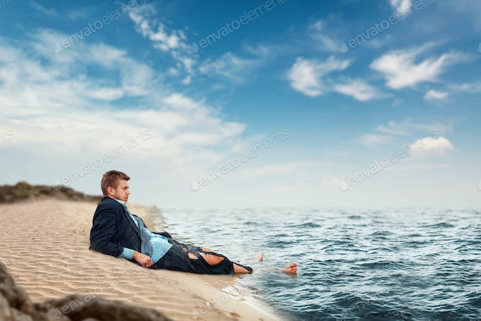Businessman resting on the beach, lost island