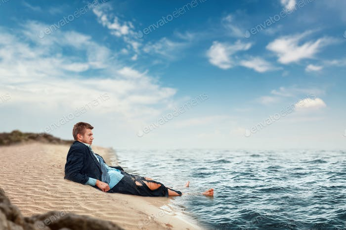 Thumbnail for Businessman resting on the beach, lost island